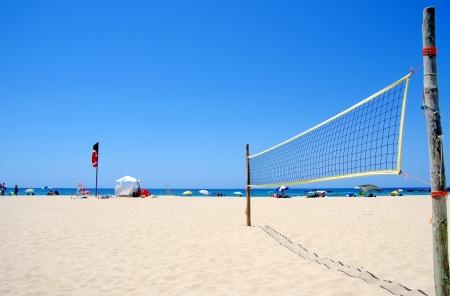 Beach Volleyball net on sandy beach at Portugal