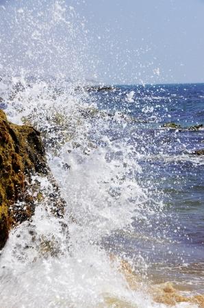 crashing: Spray of waves crashing against rock