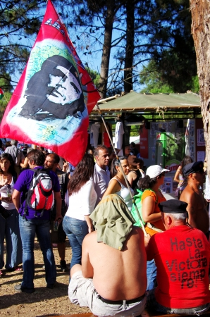 communists: SEIXAL,PORTUGAL-SEPT 7 - Protesters with Flag Che Guevara during the  Avante festival, Quinta da Atalaia, Seixal, Portugal, September 7, 2013 The festival, every year in September, is supported by the Portuguese Communists