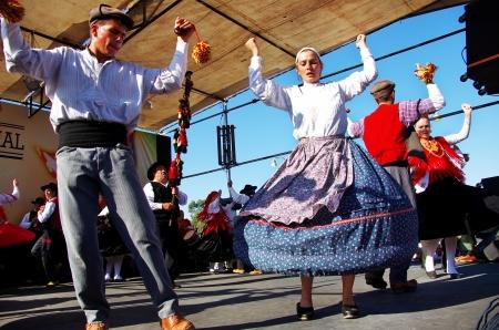 SEIXAL,PORTUGAL-SEPT 7 - Folk dance group of the Minho region, Portugal. Entertainment during the  Avante Festival.Quinta Atalaia, Seixal, Portugal, September 7, 2013.