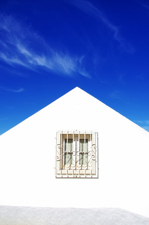 white window: White window in white wall and blue sky