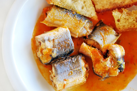 anguilla: eel stew with tomato and toasted bread Stock Photo