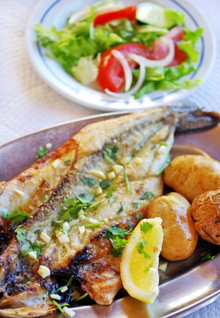 seabass: grilled seabass cooked with potatoes