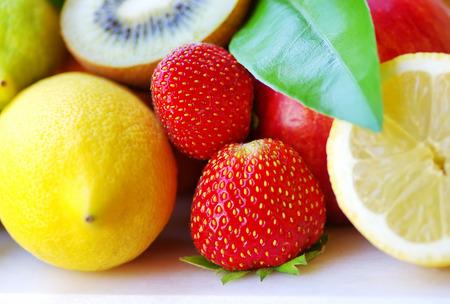 yellow lemon, kiwi and strawberry fruits  photo