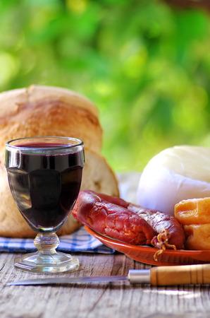 Portuguese bread, wine, cheese and chorizo photo