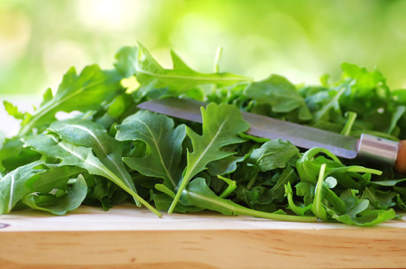 rocket lettuce: Rucola leaves and knife close-up  Stock Photo