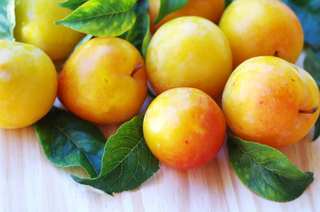 yellow plums on table photo