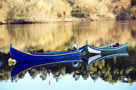 still water: boats in the river Tejo, Portugal