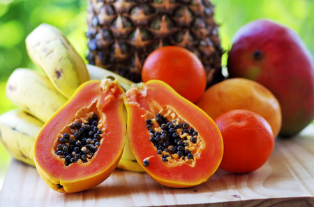 verdant: sliced papaya and fruits on the table Stock Photo