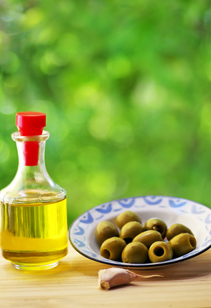 nutricion: plate of olives and oliveoil