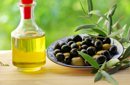 nutricion: olives on plate and oliveoil Stock Photo