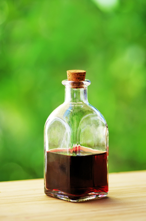 a jar stand: Glass bottle of port wine