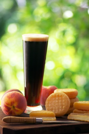 dark beer: cured cheese, fruits, and Glass of dark beer