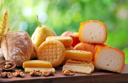 Various types of portuguese cheese on table