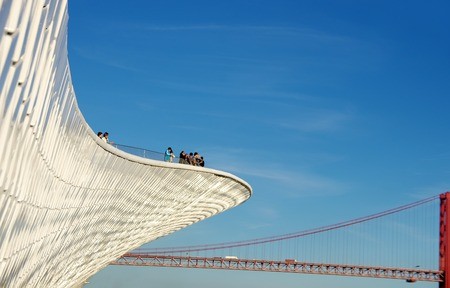 curvature: wall of museum and old bridge, Lisbon, portugal
