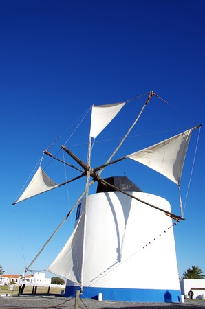 white and blue windmille at south of Portugal