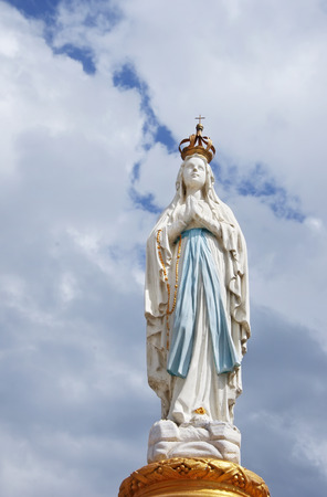 Our Lady, Virgin Mary, Mother of God in cloud sky Stock Photo