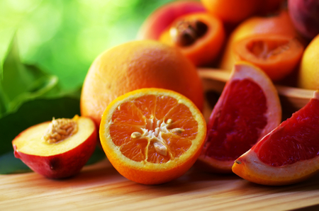 Fresh sliced fruits, orange, peach, grapefruit
