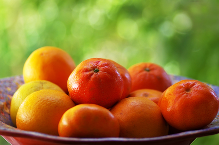 Mandarins Tangerines Closeup, green background Stock Photo
