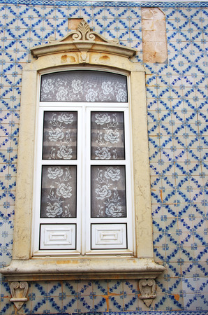 portuguese window on a tile painted wall
