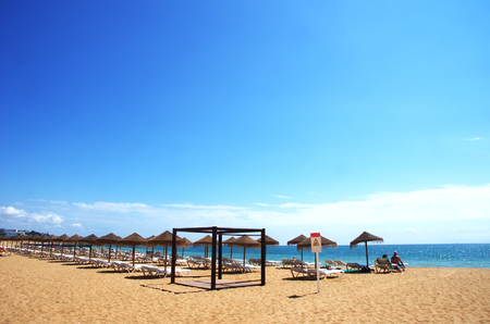 Beach with sunbeds and umbrellas, Albufeira, Portugal