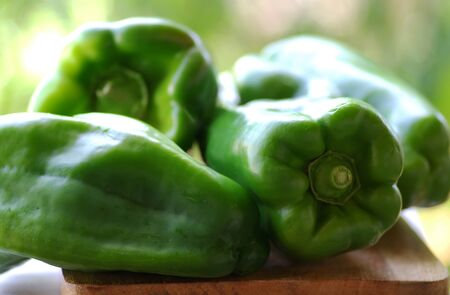 closeup of green bell peppers on table