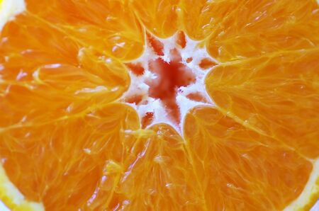 macro slice of orange fruit Standard-Bild - 131221399