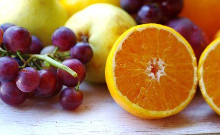 grapes and slices of orange fruit Standard-Bild - 131221406