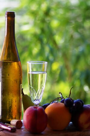 glass and bottle of green wine, Portugal Standard-Bild - 131221441