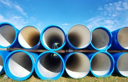 blue plastic tubes againt blue sky Standard-Bild - 136270589