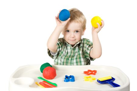 happy child playing with plasticine colorful balls Stock Photo - 6343330
