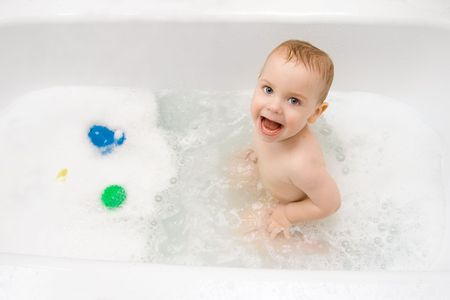 happy little child playing in bath with foam Stock Photo - 6343327