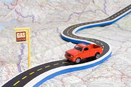 roadmap: toy car on roadmap showing petrol station Stock Photo