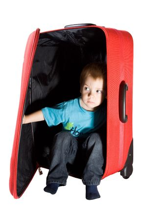troubled child hiding in suitcase and peeking out photo