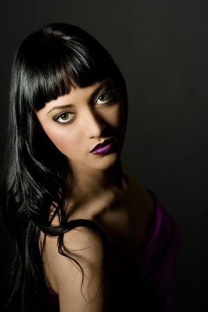 low key. Looking At Camera. portrait of a beautiful woman. Glamour purple make-up. Full lips. Green eyesfashion art photo. Stock Photo - 6811054