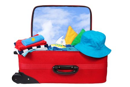 Travel red suitcase. Packed for vacation in sea resort. Personal belongings: hat, cream, towel. Isolated on white photo