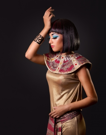 egyptian woman: Low key. Looking down. Portrait of a beautiful Egyptian woman. Stage make up       Stock Photo