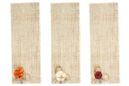 set of sackcloth tags with décor over white photo