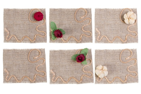 set of sackcloth tags with decor over white photo