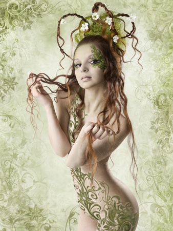 half nude: Beautiful naked woman holding long hair. Spring season. Floral background. Stock Photo
