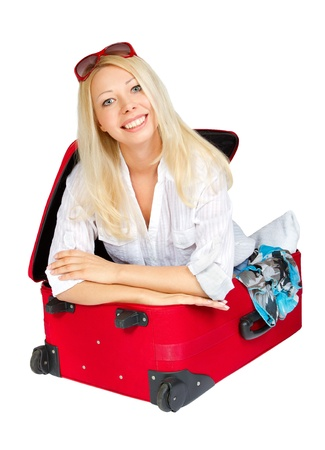 Woman with red sunglasses smiling inside red travel suitcase. Isolated  white background Stock Photo - 9168782