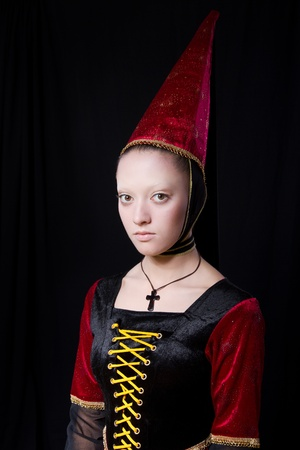 Medieval style portrait of a beautiful  woman. low key. Looking at camera. stage make up Stock Photo - 9168780