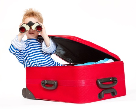 Kid with binoculars sail in red suitcase. Over  white background Stock Photo - 9168778