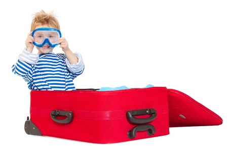 Kid with diving mask in sailor suit sail in red suitcase. Over  white background Stock Photo - 9168774