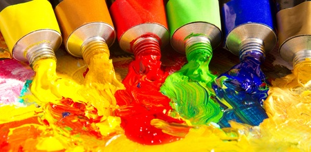 smears: Multicolored tubes of paint. Several colors on palette. Stock Photo