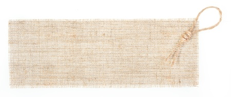sackcloth:  sackcloth tag with decor over white. see similar in portfolio