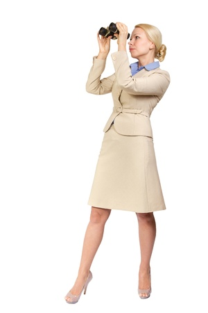 Successful business woman looks through binoculars into the future. Seeking for something. Isolated  white background photo