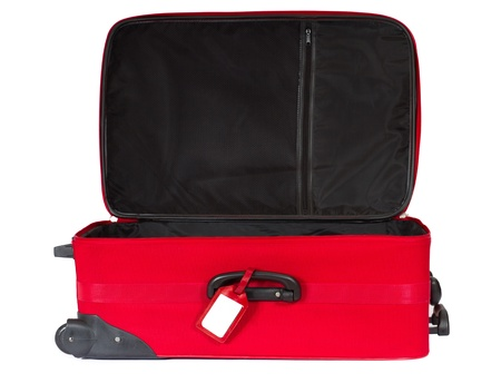 Open red suitcase with blank identification tag over white. photo