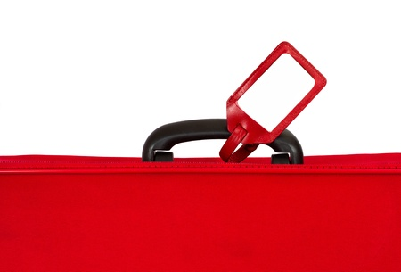 luggage tag: Red suitcase with blank identification tag over white. Closeup.