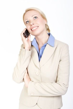 Business woman talking on the phone, looking up. Over white background. Formal wear. photo